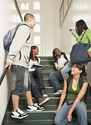 Group of friends sitting on stairs at school