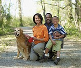 African family with dog on nature trail