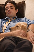 Dad after Work Asleep with Dog