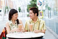 Close-up of a young couple sitting in a cafeteria