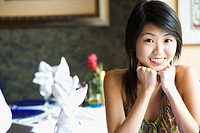 Portrait of a young woman smiling in a restaurant