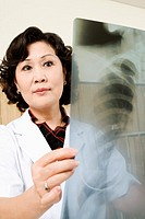 Close-up of a female doctor examining an X-Ray