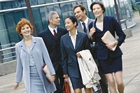 Group of business executives walking in business park