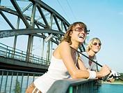 Female golfers by a bridge