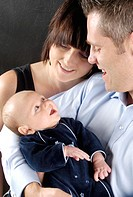 Woman with 2 week baby and husband.