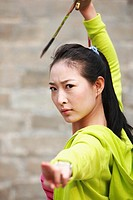 Young Woman Posing With Ceremonial Sword