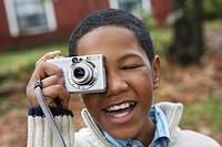 Boy Using Digital Camera Outdoors