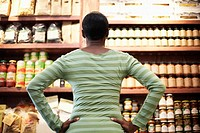 Woman Looking at Shelves of Products