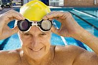 Senior Man Adjusting Swim Goggles