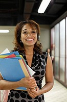 Businesswoman Holding File Folders