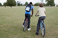 Boys riding bikes in the park