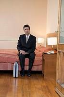 Businessman sitting in hotel room