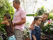 Family in a garden centre