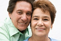 Middle-aged man and his wife smiling