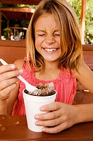 Front view of a girl eating shaved ice