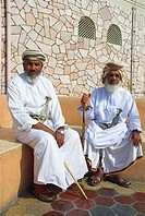 Old men dressed in traditional style with khanjar (traditional knife), at the Mutrah souq, Muscat, Oman