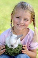 Girl holding easter bunny, close-up, portrait