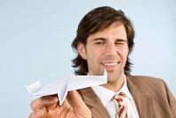 Man holding paper airplane