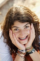 Teenager with brackets smiles at the camera