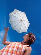Woman holding sunshade