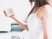 Alarm clock and woman