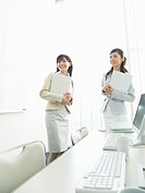Businesswomen, standing and talking each other