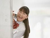 Teenagegirl smiling in corridor