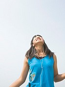 Girl listening to music happily