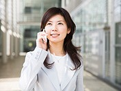 Businesswoman using a cellular phone