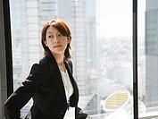 Businesswoman near by the window