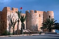 Castle on roadside under clear blue sky, Bordj El Kebir, Djerba, Tunisia