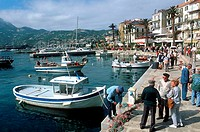 People at harbor, France