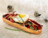 grille meat and vegetable open sandwich topped with fried egg