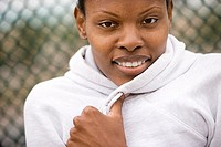Woman wearing white hooded sports top, smiling, front view, close-up, portrait