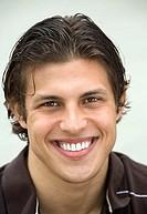 Man smiling, front view, close-up, portrait