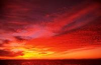 Bright orange sunset over ocean