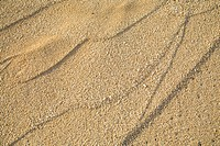 Close-up of patterns in sand