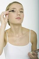 Teenage girl putting on eyeshadow