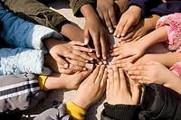 Multi Racial childrens hands