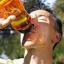 Man Drinking from Bottle