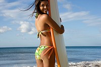 Young Woman with a Surfboard