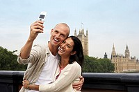 Two Tourists Using Camera Phone
