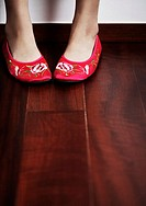 Young Woman in Red Shoes