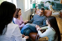 Family and Doctor Supporting Patient Getting Diagnosis