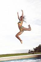 Bikini girl leaps into the swimming pool