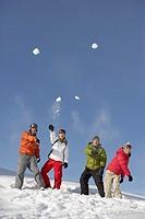 Friends throwing snowballs