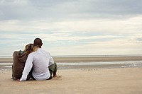 Young Couple Relaxing on Beach