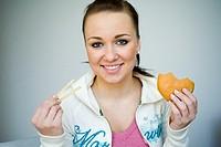 Young woman eating hamburger and potato chips