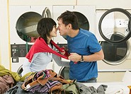 Asian couple hugging in Laundromat