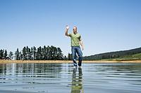 Man walking on water waving
